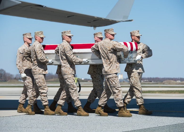 A U.S. Marine Corps carry team transfers the remains of Staff Sgt. Louis F. Cardin of Temecula, Calif., March 21, 2016, at Dover Air Force Base, Del. Cardin was assigned to the 2nd Battalion, 6th Marine Regiment, 26th Marine Expeditionary Unit, Camp Lejeune, N.C. (U.S. Air Force photo/Senior Airman Class Zachary Cacicia)