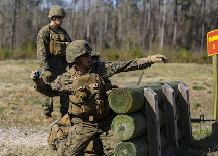 Lance Cpl. Evan D. Deniston, a military policeman with 2nd Law Enforcement Battalion, throws a dummy grenade, a non-exploding practice tool, during an assault course at Camp Lejeune, N.C., March 16, 2016. This drill is part of an annual training event to prepare them for combat situations when they are called upon to deploy. Marines took turns providing cover fire for their partner, allowing them to throw a dummy grenade near the simulated enemy position (U.S. Marine Corps photo by Lance Cpl. Aaron K. Fiala/Released)
