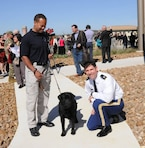 Lt. Col. Clay Morgan, deputy commander, Fort Worth District, poses with TSA trainer J.J. Wilson and his dog, Max, after the building dedication ceremony
