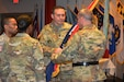 Command Sgt. Maj. Arlindo Almeida, outgoing senior noncommissioned officer of the 94th Training Division, hands the command colors to Brig. Gen. Steven W. Ainsworth, the 94th TD commander, symbolizing Almeida's relinquishment of his duties. The change of responsibility took place during a ceremony at Fort Lee, Va., March 18, 2016. Ainsworth then passed the colors to Command Sgt. Maj. Sharon Campbell, making her the 94th TD's new senior noncommissioned officer. Campbell is now the first female to hold the senior NCO position at the 94th TD.