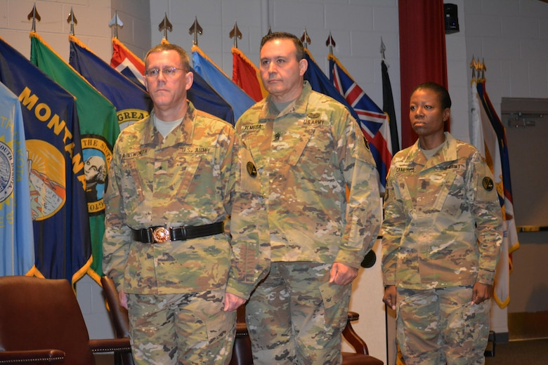 From left to right, Brig. Gen. Steven W. Ainsworth, the 94th Training Division commander, Command Sgt. Maj. Arlindo Almeida, outgoing senior noncommissioned officer, 94th TD and Command Sgt. Maj. Sharon Campbell, the 94th TD's new command sergeant major, during a change or responsibility ceremony, where Campbell became the division's first female command sergeant major March 18, 2016.