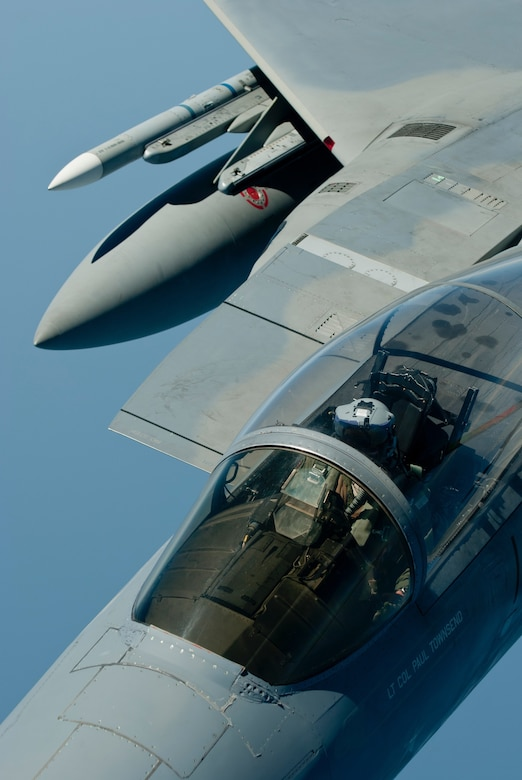 A U.S. Air Force F-15C Eagle fighter pilot with the 44th Fighter Squadron conducts an inflight refueling exercise with a KC-135 Stratotanker from the 909th Air Refueling Squadron, March 21, 2016, off the coast of Japan. With around-the-clock tanker support, U.S. and coalition forces can conduct long-range air operations for an indefinite amount of time in order to carry out aerial support and theater security throughout the Indo-Asia-Pacific region.  (U.S. Air Force photo by Senior Airman Peter Reft/Released)
