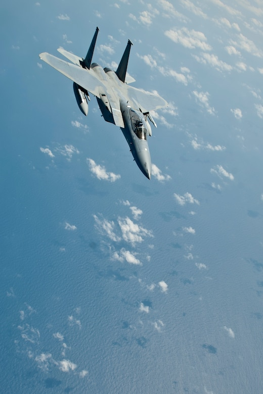 A U.S. Air Force F-15C Eagle aircraft with the 44th Fighter Squadron pulls away after completing inflight refueling, March 21, 2016, off the coast of Japan. 44th FS pilots maintain 24-hour readiness to provide regional security throughout the Indo-Asia-Pacific region night or day at a moment's notice. (U.S. Air Force photo by Senior Airman Peter Reft/Released)