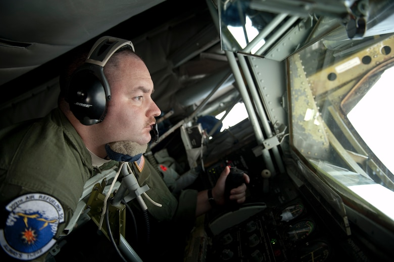 U.S. Air Force Staff Sgt. David Ballmer, 909th Air Refueling Squadron boom operator, performs an inflight refueling procedure, March 21, 2016, off the coast of Japan. Specially trained aircrews from the 909th ARS provide around-the-clock tanker support for U.S. and coalition forces, enabling asset and theater protection throughout the Indo-Asia-Pacific region. (U.S. Air Force photo by Senior Airman Peter Reft/Released)