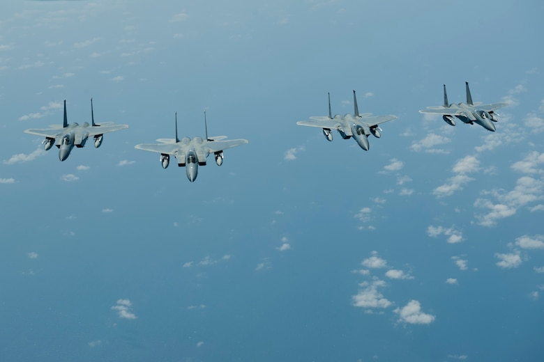 Four U.S. Air Force F-15C Eagle aircraft with the 44th Fighter Squadron fly in formation, March 21, 2016, off the coast of Japan. The F-15C is an all-weather, highly maneuverable tactical fighter that enables the Air Force to gain and maintain air supremacy over the battlefield. (U.S. Air Force photo by Senior Airman Peter Reft/Released)