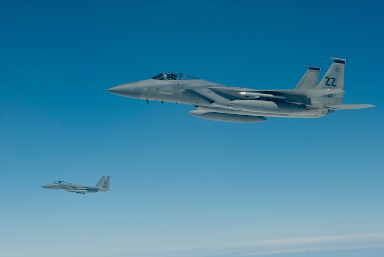 Two U.S. Air Force F-15C Eagle aircraft with the 44th Fighter Squadron fly in formation during an inflight refueling exercise, March 21, 2016, off the coast of Japan. 44th FS pilots carry out contingency operations and provide around-the-clock theater security throughout the Indo-Asia-Pacific region. (U.S. Air Force photo by Senior Airman Peter Reft/Released)