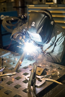 U.S. Air Force Airman 1st Class Joshua Tears-Knapp, 23d Equipment Maintenance Squadron aircraft metals technology journeyman, uses a metal inert gas welder to fabricate a bracket, March 18, 2016, at Moody Air Force Base, Ga. Metals technology technicians support perform 3,000 fabrication and repair jobs annually in support of approximately 70 aircraft and nearly 700 aerospace ground equipment units on base. (U.S. Air Force photo by Airman 1st Class Greg Nash/Released)