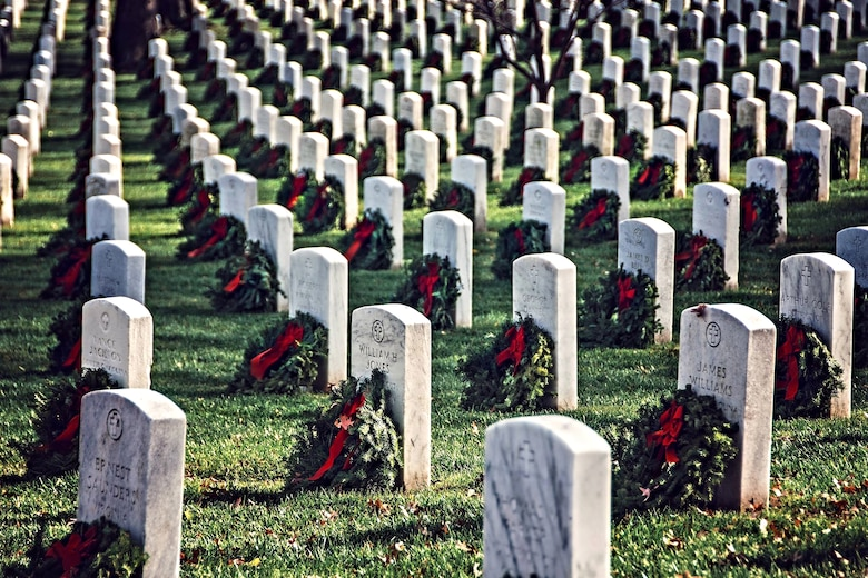 Thousands of volunteers placed approximately 230,000 evergreen wreaths at Arlington National Cemetery as part of the Wreaths Across America program on Dec. 13, 2015. The holiday tradition began in 1992 with 5,000 wreaths, and now has expanded to more than 1,000 fundraising groups in all 50 states, who place wreaths at hundreds of cemeteries and other military memorial sites across the country.