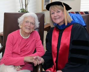 NIU Provost Dr. Susan Studds shakes hands with former First Lady Barbara Bush