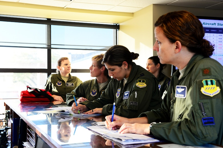 An all-female aircrew is briefed before their flight at Barksdale Air Force Base, La., March 22, 2016. To celebrate women's history month, two all-female aircrews were assembled to make U.S. Air Force history by being the first all-female aircrew to fly a B-52 Stratofortress. (U.S. Air Force photo/Airman 1st Class Luke Hill)