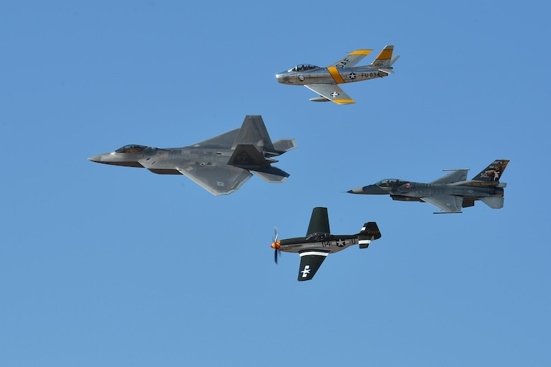 A Heritage Flight formation flies over show center during the 2016 Heritage Flight Training Course demonstration at Davis-Monthan Air Force Base, Ariz., March 5, 2016. The Heritage Flight Training Course allows pilots assigned to the three Air Combat Command demonstration teams to practice their demonstrations with the Heritage Flight pilots, displaying a formation of modern and historic aircraft. (U.S. Air Force photo by Senior Airman Diana M. Cossaboom)