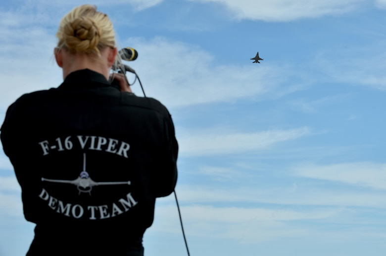 "U.S. Air Force Staff Sgt. Cassy Moore, F-16 Viper Demonstration Team avionics specialist, records Maj. Craig ""Rocket"" Baker, F-16 Viper Demo Team pilot, during a demo practice at the 2016 Heritage Flight Training Course at Davis-Monthan Air Force Base, Ariz., March 2, 2015. Moore records Baker every time he flies a demonstration to ensure his safety while he pushes the F-16 to its maneuvering limits. (U.S. Air Force photo by Senior Airman Diana M. Cossaboom)"
