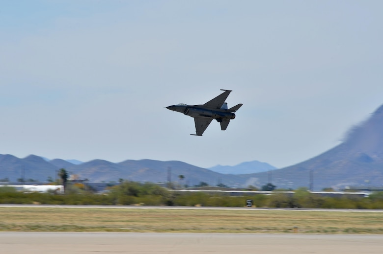 "U.S. Air Force Maj. Craig ""Rocket"" Baker, F-16 Viper Demonstration Team pilot, takes off during an aerial demonstration at the 2016 Heritage Flight Training Course at Davis-Monthan Air Force Base, Ariz., March 4, 2016. Air Combat Command supports three demonstration teams that perform world-wide displaying the combat ready air power of U.S. Air Force. (U.S. Air Force photo by Senior Airman Diana M. Cossaboom)"