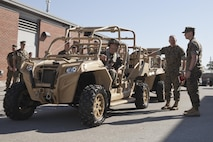 Commandant of the Marine Corps Gen. Robert B. Neller discusses the MRZR Tactical Warfighter all-terrain vehicle at Stone Bay, Marine Corps Base Camp Lejeune, N.C., March 17, 2016. Neller toured Marine Special Operations Command facilities, observed their equipment, and met with Marine Raiders. (U.S. Marine Corps photo by Cpl. Samantha K. Draughon/Released)