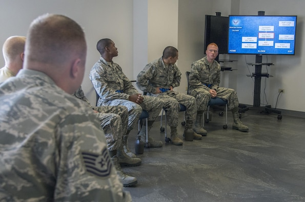 """Airmen participate in the """"What Now Airman?"""" training session during Airmen's Week at the 326th Training Squadron at Joint Base San Antonio-Lackland-Texas. Airmen's Week began March 20, 2015, as an initiative from Chief Master Sgt. Of the Air Force James A. Cody to develop a program to instill pride, a commitment to core values and professionalism earlier in an Airman's career. Airmen attend the course after successfully completing Air Force basic military training. (Photo by Johnny Saldivar)"""