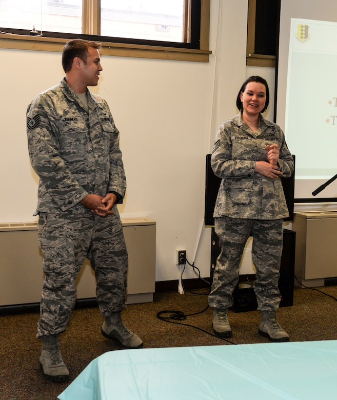 """Tech. Sgts. Brian and Leah Thomas, 28th Force Support Squadron Airman and Family Readiness Center readiness NCO, and 28th Operations Support Squadron unit deployment manager, respectively, speak about their experience as foster parents during the """"Why Not You?"""" campaign at Ellsworth Air Force Base, S.D., March 15, 2016. Many representatives spoke about the adoption and fostering programs their agencies offers. (U.S. Air Force photo by Airman 1st Class Sadie Colbert/Released)"""