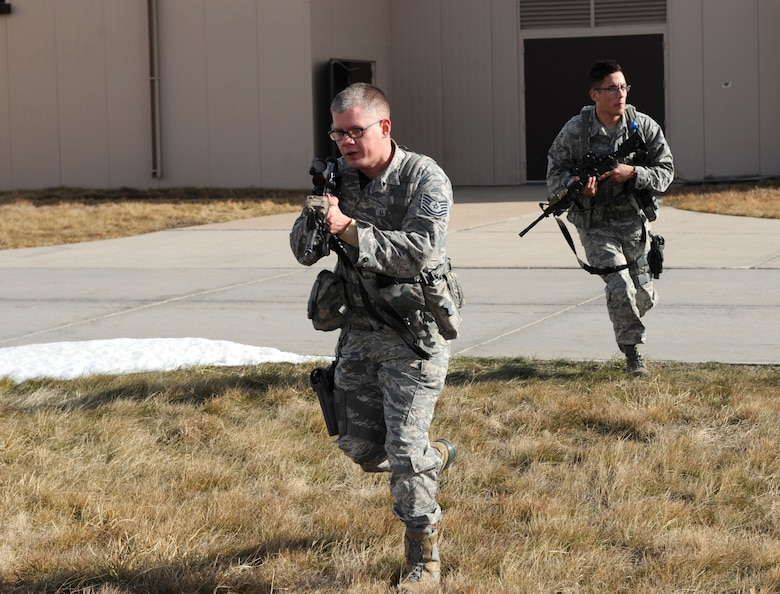 Tech. Sgt. Steven Groff, 28th Security Forces Squadron flight chief, and Airman 1st Class Christopher Dominguez, 28th SFS response force member, participate in a training exercise at Ellsworth Air Force Base, S.D., Feb. 10, 2016. Airmen of the 28th SFS engage in more than 200 hours of training annually, which include combative skills and law enforcement training. (U.S. Air Force photo by Airman 1st Class Denise M. Nevins/Released)