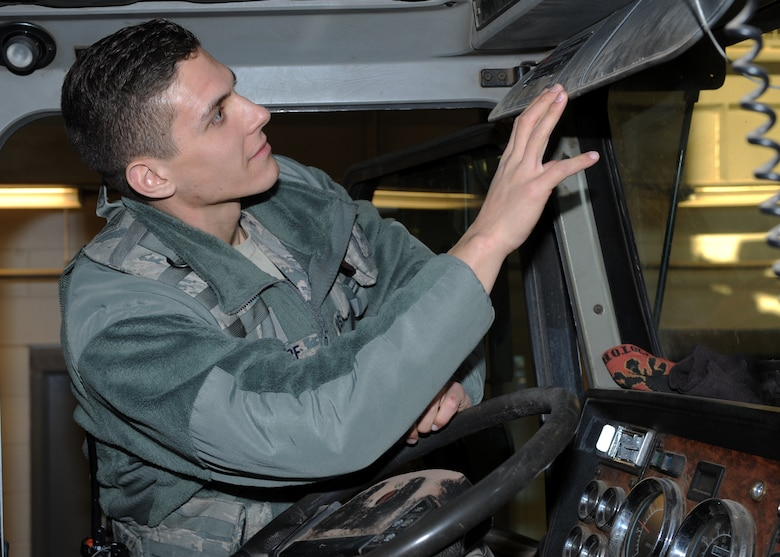 Airman 1st Class John Stumpf, 28th Security Forces Squadron response force member, inspects a commercial truck prior to authorizing entrance to Ellsworth Air Force Base, S.D., Feb. 10, 2016. Security forces personnel are the Air Force's first line of defense and it is their job to uphold the law on all Air Force installations. (U.S. Air Force photo by Airman 1st Class Denise M. Nevins/Released)