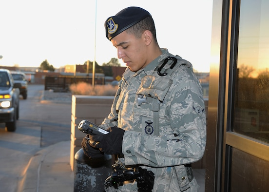 Airman Brandon Hickman, 28th Security Forces Squadron response force member, verifies ID cards at the gates of Ellsworth Air Force Base, S.D., Feb. 10, 2016. Airmen of the 28th SFS use the Defense Biometric Identification System to determine if an individual is authorized entry to the base. (U.S. Air Force photo by Airman 1st Class Denise M. Nevins/Released)