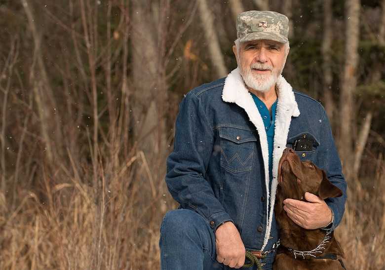 Ken Bylow, an Army veteran who served in Vietnam during the Tet Offensive, poses with his new service dog, Cowboy. Cowboy was given to him by a nonprofit organization after losing his previous service dog. During his time in Vietnam, Bylow earned a Bronze Star Medal with V for Valor. (U.S. Air Force photo by Airman 1st Class Kyle Johnson)