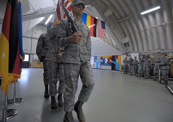 U.S. Air Force Honor Guard members demonstrate color guard movements to members of the Ramstein Honor Guard March 15, 2016, at Ramstein Air Base, Germany. Ramstein Honor Guard members got the opportunity to learn uniform preparation and color guard motions from U.S. Air Force Honor Guard members. (U.S. Air Force photo/Staff Sgt. Timothy Moore)
