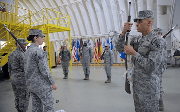 Senior Airman Angelo Hightower, U.S. Air Force Honor Guard Drill Team member, demonstrates the motions to perform right shoulder March 15, 2016, at Ramstein Air Base, Germany. Ramstein Honor Guard members got the opportunity to learn uniform preparation and color guard motions from U.S. Air Force Honor Guard members. (U.S. Air Force photo/Staff Sgt. Timothy Moore)