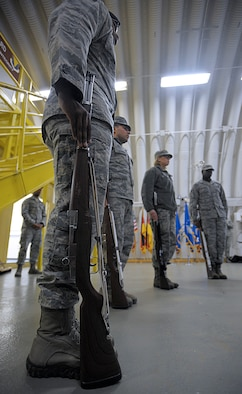 Members of the Ramstein Honor Guard practice the placement of ceremonial rifles March 15, 2016, at Ramstein Air Base, Germany. The honor guardsmen, who are assigned to different units across Ramstein, got the opportunity to learn from members of the U.S. Air Force Honor Guard. (U.S. Air Force photo/Staff Sgt. Timothy Moore)