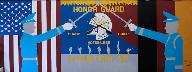 A mural for the Ramstein Honor Guard is displayed March 15, 2016, at Ramstein Air Base, Germany. The mural shows the U.S. and German flags as well as the motto for the Ramstein Honor Guard: sharp, crisp and motionless. (U.S. Air Force photo/Staff Sgt. Timothy Moore)