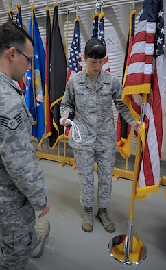 Senior Airman Amber Marcum, U.S. Air Force Honor Guard base honor guard program coordinator, discusses ways to display flags with Staff Sgt. Casey Chillemi, 86th Munitions Squadron munitions controller, March 15, 2016, at Ramstein Air Base, Germany. Chillemi and other members of the Ramstein Honor Guard learned skills and techniques from U.S. Air Force Honor Guard members to become better honor guardsmen. (U.S. Air Force photo/Staff Sgt. Timothy Moore)