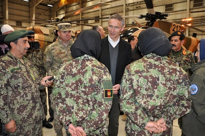 Jens Stoltenberg, NATO Secretary General (middle), talks with Afghan Air Force‬ women soldiers during a visit with AAF and Train, Advise, Assist Command-Air (TAAC-Air) personnel March 16, 2016, at Hamid Karzai International Airport, Afghanistan. He wanted to learn about the air force missions and reaffirm support to NATO's international partners‬. (U.S. Air Force photos by Capt. Eydie Sakura/released)