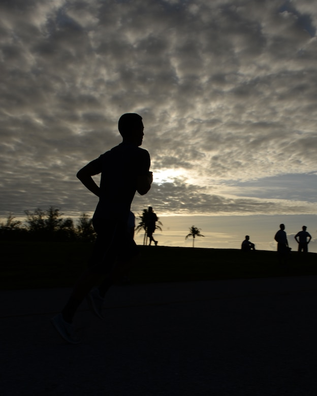 A runner sprints to the finish of the Loose Change 5k March 21, 2016, at Andersen Air Force Base, Guam. The 5k kicked off Andersen AFB's effort to support the Air Force Assistance Fund's goal of raising $6.78 million Air Force wide. (U.S. Air Force photo/Airman 1st Class Jacob Skovo)