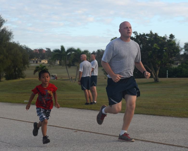 Runners in the Loose Change 5k run to the finish line March21, 2016, at Andersen Air Force Base, Guam. The 5k kicked of Andersen AFB's support of the Air Force Assistance Fund, which is powered by Airmen and aims to take care of Airmen in need.(U.S. Air Force photo/Airman 1st Class Jacob Skovo)