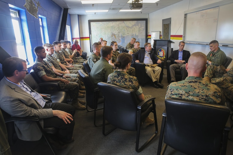 Rep. Mac Thornberry, center-right, speaks with Marines from Marine Heavy Helicopter Squadron 461 at Marine Corps Air Station New River, N.C., March 18, 2016. Thornberry met with various units at Marine Corps Air Stations Beaufort and New River, and Marine Corps Base Camp Lejeune to discuss force-related issues. (U.S. Marine Corps photo by Cpl. Lucas Hopkins/Released)