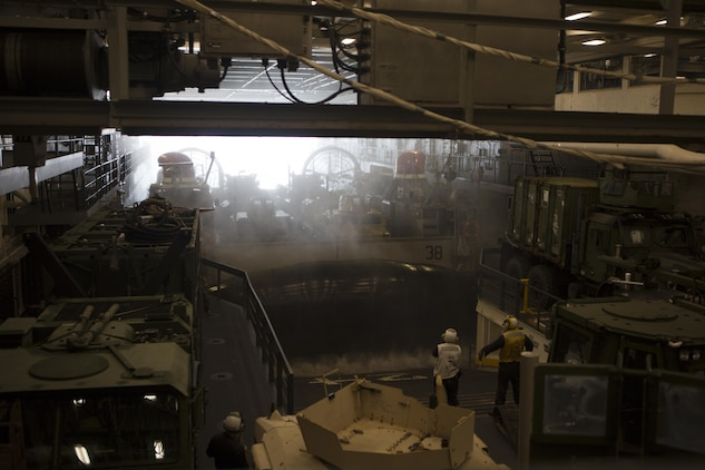 A U.S. Navy Landing Craft Air Cushion transporting Marines and vehicles with the 26th Marine Expeditionary Unit (MEU), boards the USS Arlington (LPD 24) Oct. 9, 2015. Navy scientists and engineers are developing a modeling and simulation tool that will help determine if Marine Corps vehicles and equipment can be stowed on Navy vessels like the USS Arlington (LPD 24). (U.S. Marine Corps photo by Cpl. Jeraco Jenkins)