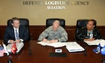 David Gibson, site director, Defense Logistics Agency Installation Support at Richmond and Lucy Lewis, president, American Federation of Government Employees Local 1992, look on as DLA Aviation Commander Air Force Brig. Gen. Allan Day signs the application March 15, 2016, requesting an Occupational Safety and Health Administration inspection to determine Defense Supply Center Richmond's qualification for earning a star under OSHA's Voluntary Protection Program.