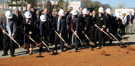 DAHLGREN, Va. - Navy leadership is joined by members of Congress at a groundbreaking ceremony for the new Naval Surface Warfare Center Dahlgren Division (NSWCDD) Missile Support Facility, March 18. The facility will feature state-of-the-art labs, offices, and equipment for more than 300 NSWCDD Strategic and Computing Systems Department scientists, engineers, and technical experts who develop, test, and maintain the Submarine Launched Ballistic Missile (SLBM) fire control and mission planning software. From left to right: Brad Hunley, construction executive for Mortenson Construction; Capt. Mary Feinberg, commanding officer for Naval Support Activity South Potomac; Dennis McLaughlin, NSWCDD technical director; Rep. Rob Wittman, R-Va.; Sen. Tim Kaine, D-Va.; Vice Adm. Terry Benedict, director of Navy Strategic Systems Programs; Capt. Brian Durant, NSWCDD commanding officer; John Fincannon, Senior Executive Service, Strategic Systems Programs; Cmdr. William Windus, Naval Facilities Engineering Command Public Works Officer.