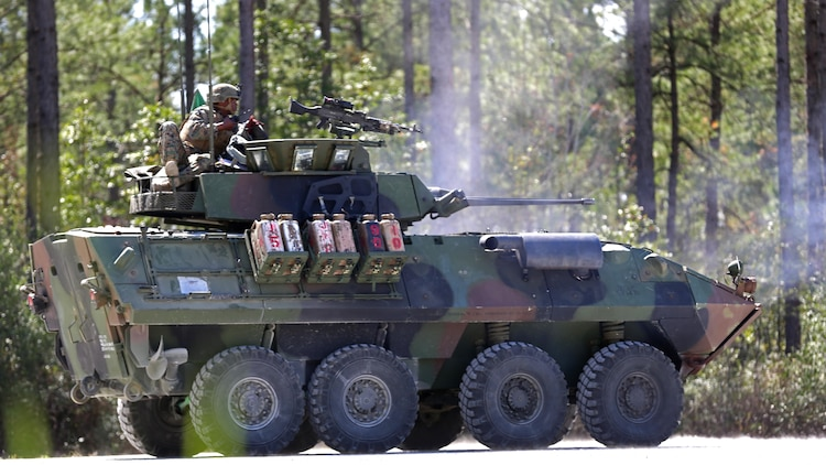 Marines operating a Light Armored Vehicle with 2nd Light Armored Reconnaissance Battalion fire a M242 Bushmaster 25 mm chain-driven auto-cannon during the unit's annual gunnery qualification at Marine Corps Base Camp Lejeune, North Carolina, March 18, 2016. The purpose of the training was to increase readiness and ensure that the Marines maintain their proficiency employing the weapons.