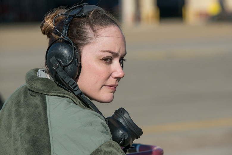 U.S. Air Force Tech. Sgt. Megan Nelson, 2nd Maintenance Squadron crew chief, prepares to marshal a B-52H Stratofortress from its parking spot for a mission on Mar. 22, 2013, Barksdale Air Force Base, La. In recognition of Women's History Month, the Air Force Reserve Command's 307th Bomb Wing and Barksdale's 2nd Bomb Wing launched two B-52H Stratofortress bombers flown by two all-female aircrews made up from members of the Air Force Reserve Command's 93rd and 343rd Bomb Squadrons and the 2nd Bomb Wing's 11th, 20th and 96th Bomb Squadrons. (U.S. Air Force photo by Master Sgt. Greg Steele/Released)