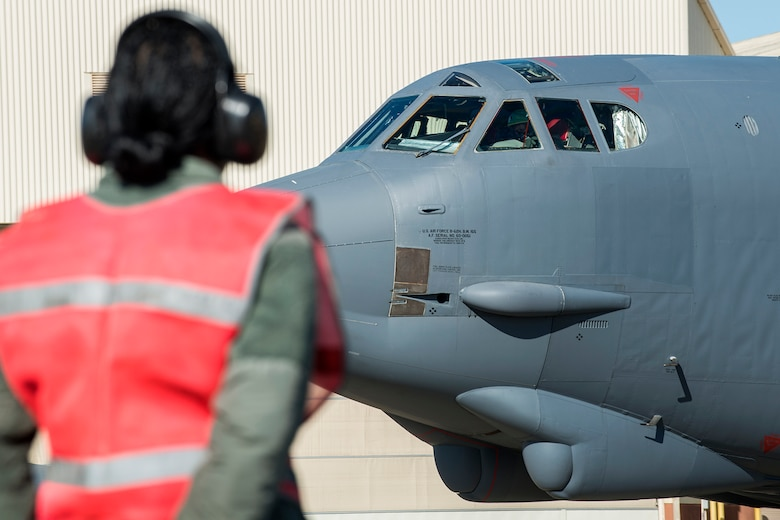 U.S. Air Force Tech. Sgt. Holly Guerra, assigned to the 307th Aircraft Maintenance Squadron, prepares to marshal a B-52H Stratofortress from its parking spot for a mission on Mar. 22, 2013, Barksdale Air Force Base, La. In recognition of Women's History Month, the Air Force Reserve Command's 307th Bomb Wing and Barksdale's 2nd Bomb Wing launched two B-52H Stratofortress bombers flown by two all-female aircrews made up from members of the Air Force Reserve Command's 93rd and 343rd Bomb Squadrons and the 2nd Bomb Wing's 11th, 20th and 96th Bomb Squadrons. (U.S. Air Force photo by Master Sgt. Greg Steele/Released)