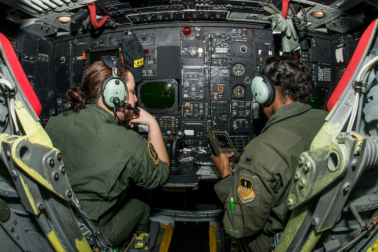 Two U.S. Air Force B-52 navigators prepare for a mission on Mar. 22, 2013, Barksdale Air Force Base, La. In recognition of Women's History Month, the mission consisted of two B-52H Stratofortress bombers flown by two all-female aircrews made up from members of the Air Force Reserve Command's 93rd and 343rd Bomb Squadrons and the 2nd Bomb Wing's 11th, 20th and 96th Bomb Squadrons. (U.S. Air Force photo by Master Sgt. Greg Steele/Released)