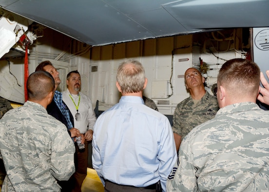 "Experts from the Air Force Life Cycle Management Center, the Air Force Reserve, National Guard Bureau and the Legacy Tanker Division, view maintenance work on a KC-135 ""Stratotanker"" maintained by the 507th Maintenance Group March 16, 2016, at Tinker Air Force Base, Okla. The group, headed by Maj. Gen. Glenn Davis, Mobilization Assistant to the Commander, AFLCMC, Wright-Patterson Air Force Base, Ohio, visited the 507th Air Refueling Wing, Birmingham Air National Guard Base, Alabama, and Grissom Air Reserve Base, Indiana to enhance KC-135 customer service between all the agencies. (U.S. Air Force Photo/Maj. Jon Quinlan)"