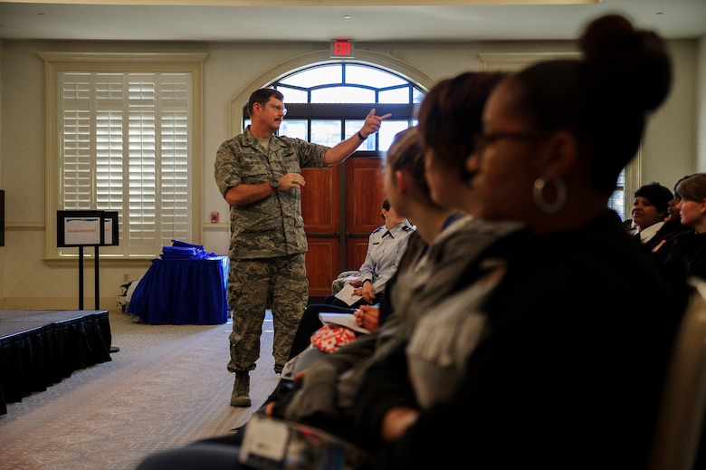 Col. Gregory Gilmour, 315th Airlift Wing commander, welcomes Lowcountry school girls to the 9th Annual Women in Aviation Career Day. Over 130 middle and high school girls from 12 Lowcountry schools visited Joint Base Charleston March 22 to learn about jobs in aviation as part of the 315th Airlift Wing event.	(U.S. Air Force photo by Senior Airman Jonathan Lane)