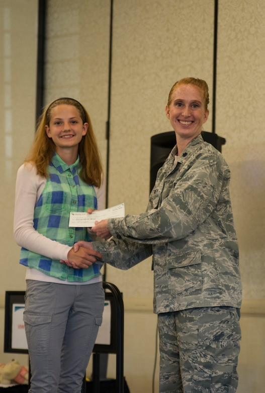 Lt. Col. Mary Jeffrey, 315th Operations Group executive officer, congratulates Jessica Turnbaugh, Hanahan High School, for winning 2nd place in the Women in Aviation Career Day essay contest.Over 130 middle and high school girls from 12 Lowcountry schools visited Joint Base Charleston March 22 to learn about jobs in aviation as part of the 315th Airlift Wing's 9th annual Women in Aviation Career Day. (U.S. Air Force photo by Senior Airman Jonathan Lane)