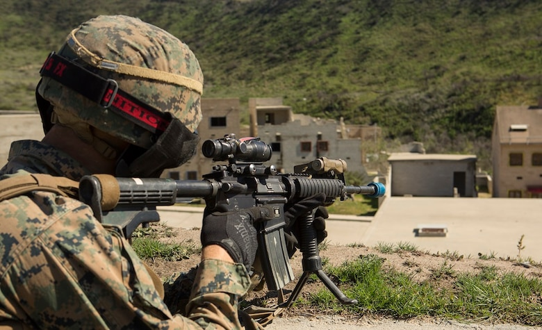 A Marine with 1st Marine Division sights in on a building during a three-week urban operations course led by 1st Marine Division Schools, Urban Leaders Course at Camp Pendleton March 8, 2016. During the course, unit leaders cover urban terrain tactics like combat marksmanship, dynamic breaching, close quarters battle and room clearing. (U.S. Marine Corps photo by Lance Cpl. Justin E. Bowles/ Released)