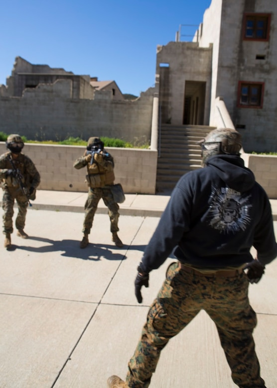 Marines with 1st Marine Division attempt to arrest a simulated enemy combatant during a three-week urban operations course led by 1st Marine Division Schools, Urban Leaders Course at Camp Pendleton March 8, 2016. During the course, unit leaders cover urban terrain tactics like combat marksmanship, dynamic breaching, close quarters battle and room clearing. (U.S. Marine Corps photo by Lance Cpl. Justin E. Bowles/ Released)