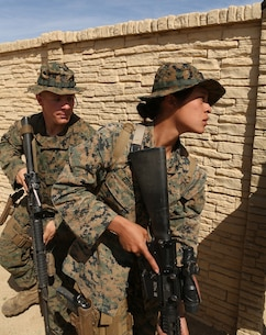 Cpl. Brier Avara and Cpl. Marissa Ezinga perform tactical column maneuvers during military operations on urban terrain training at Camp Pendleton March 3, 2016. Marines with 1st Law Enforcement Battalion conducted a five-day offensive training evolution in an effort to better integrate military police officers with infantry units. Avara, a native of Monroe, La., and Ezinga, native of Vallejo, are military police officers with Company B, 1st LE Bn., I Marine Expeditionary Force. (U.S. Marine Corps photo by Lance Cpl. Justin E. Bowles/Released)