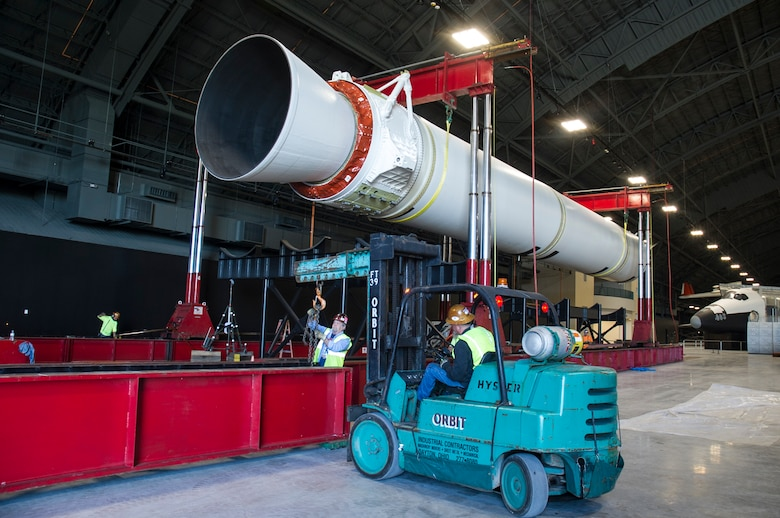 DAYTON, Ohio - Titan IVB stage one, and the solid rocket motor upgrades(SRMU's) were raised into their final position from 14-18 March, 2016. Orbit Industrial Contractors, Consolidated Machinery Movers, and museum restoration crews worked together using various lifts and a gantry crane system. The impressive Titan IVB, with roots going back to the early days of U.S. Air Force and civil space launch, is significant as the museum looks to share the story of USAF and USAF-enabled space operations in its Space Gallery. The Titan IVB will be on display in the new fourth building at the National Museum of the U.S. Air Force which opens to the public on June 8. (U.S. Air Force photo by Ken LaRock)