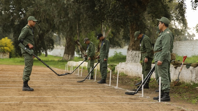 A Moroccan Royal Marine speaks to other military members prior to conducting a mine sweeping exercise in Kenitra, Morocco, March 15, 2016. Students from across the Moroccan military branches are working together with U.S. Marine and Utah Air National Guard explosive ordnance disposal technicians and Utah National Guard engineers to build up Morocco's demining capabilities. The training is part of the U.S. Humanitarian Mine Action Program which has been assisting partner nations in developing their mine action capacity since 1988.