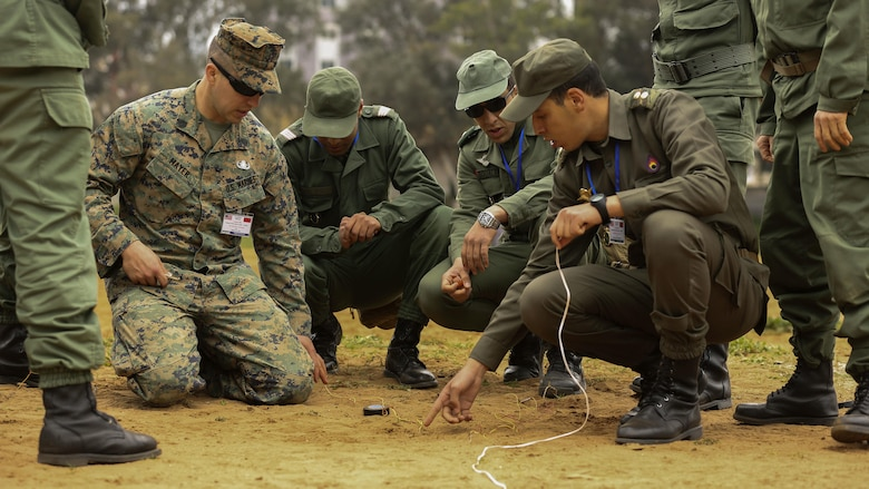 U.S. Marine Staff Sgt. Phil Mayer, an explosive ordnance disposal technician with Special-Purpose Marine Air-Ground Task Force Crisis Response-Africa, explains how to safely create electric firing circuits for demolition during a training exercise in Kenitra, Morocco, March 15, 2016. Students from across the Moroccan military branches are working together with U.S. Marine and Utah Air National Guard explosive ordnance disposal technicians and Utah National Guard engineers to build up Morocco's demining capabilities. The training is part of the U.S. Humanitarian Mine Action Program which has been assisting partner nations in developing their mine action capacity since 1988. (U.S. Marine Corps photo by Cpl. Olivia McDonald/Released)