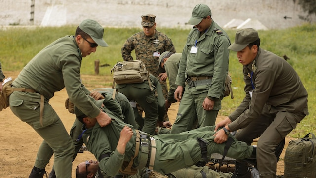 Moroccan soldiers ready a casualty for transport during a notional casualty training exercise in Kenitra, Morocco, March 15, 2016. Students from across the Moroccan military branches are working together with U.S. Marine and Utah Air National Guard explosive ordnance disposal technicians and Utah National Guard engineers to build up Morocco's demining capabilities. The training is part of the U.S. Humanitarian Mine Action Program which has been assisting partner nations in developing their mine action capacity since 1988.